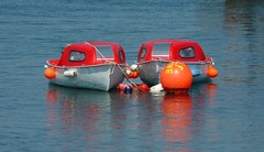 Red on the Water (Clear Lady) Tags: red sea two reflection water boats twins couple dorset ripples lymeregis floats