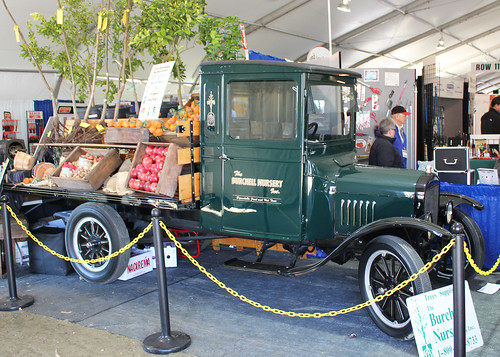 An antique truck serves as an exhibit booth during the expo.