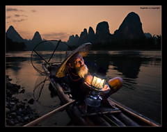 When Time Stood Still - X (Ragstatic) Tags: life china old light sunset portrait sky orange mountain net water face hat silhouette clouds river hair beard liriver li fishing eyes nikon exposure dusk stones guilin rags culture bank tags bamboo age cormorant raft lantern ng tradition karst range wrinkles guangxi lifescape d700