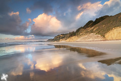 Buried Treasure - San Gregorio State Beach (Joshua Cripps) Tags: ocean california blue orange seascape water glass clouds america reflections mirror coast sand nikon shine pacific wave sangregorio d300 cumulous statebeach nikkor18200 joshuacripps