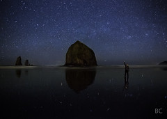 Haystack Rock (Ben Canales) Tags: ocean man reflection male beach night oregon dark stars person star coast twilight model sand ben spires shore haystack cannon cannonbeach haystackrock starry canales bencanales thestartrail haystackrockatnight