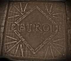 Detroit and some of its nicknames (SCOTTS WORLD) Tags: city urban digital fun downtown michigan name detroit plate adventure sidewalk walkabout february sewer lid fujifinepix artisitic motown citysigns themotorcity 2011 nicknames thebigd deetroit othernames daytwah