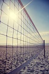 Beach Volleyball on Nobbys Beach (Leighton Wallis) Tags: sun net beach silhouette newcastle sand surf australia beachvolleyball nsw nobbysbeach