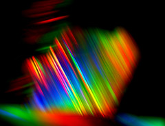 Prism 3 (Jane in Colour) Tags: blue light red abstract color colour macro green yellow rainbow spectrum bright stripes cosina prism suncatcher colourful alpha diffraction tpc holographic sonya100 minoltaamount janethomas janeincolour tpcu14 tpcu14l4