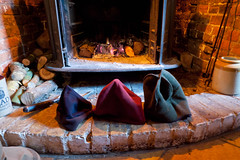 Hats drying in front of pub fire