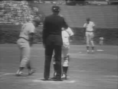0d302c125 ... but the umps working the bases had eschewed their jackets and were  working in shirt sleeves — pretty standard for a warm day.