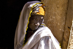 Old Woman in Sunlight (Steven House) Tags: africa trip travel portrait people woman color sahara village islam tribal fabric westafrica oldwoman mali ethnic touareg tuareg mopti afrique saharadesert