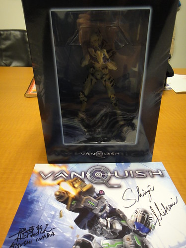 Vanquish Statue and Signed Art