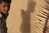 raju, nimb-ki-dhani (nevil zaveri (thank you for 10 million+ views :)) Tags: zaveri india jaisalmer rajasthan thar desert wall mudhouse mud house photography photographer images photos rural village home dwelling hut architecture blog stockimages photograph photographs nimbkidhani window nevil nevilzaveri stock photo windows people boy boys child children kid kids door pillow doorsandwindows shadow