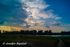 As she sun slowly sets over the Rhine (Bernsteindrache7) Tags: summer sony alpha 100 flora fauna flower rhine dsseldorf germany nrw sky heaven himmel color clouds panorama water wasser