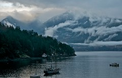 a patch of blue in the upper left (LUMIN8) Tags: blue winter sky mist snow canada reflection misty vancouver clouds sailboat raw availablelight britishcolumbia bowen howesound cypress seatoskyhighway deepbay northshoremountains cans2s