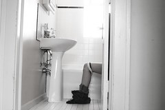 January 30 (denarose) Tags: light blackandwhite home bathroom bathrooms sink underwear legs humor toilet doorway bog timer ankles lu selftimer funnypicture 10seconds pantsdown oddperspective cameratimer 10secondtimer funnyportrait usingthebathroom throughthedoorway humorselfportrait theovaloffice pantsonankles
