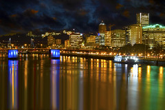 Portland Downtown City Skyline by Waterfront at Night (David Gn Photography) Tags: road park city travel light sky motion blur reflection cars architecture night oregon buildings river portland lights star evening office highway long exposure downtown raw industrial waterfront traffic dusk district trails bridges sigma peak vehicles transportation freeway esplanade pdx hours bluehour morrison hawthorne metropolitan hdr willamette burnside burs