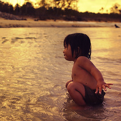 She's hooked (DSC2583) (Fadzly @ Shutterhack) Tags: ocean sunset sea people baby reflection beach girl d50 square landscape nikon bokeh candid daughter malaysia ripples terengganu kualaterengganu 3520 summicronr tokjembal leitax dwcffchild