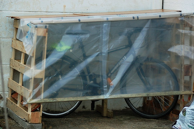 Homemade bike shed, constructed from junk materials