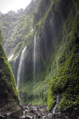 Madakaripura Waterfall (elcastelcom) Tags: park travel foothills nature water beautiful rock stone canon river indonesia eos prime java waterfall bath angle flood ministry sightseeing wide holy national valley tropical romantic environment 5d gorge cave tirta gajah jawa breathtaking 1740 bromo indonesi tengger 1740l rainforrest waterval mada grot 17mm eastjava jawatimur encircled majapahit probolinggo bromotenggersemeru sewana madakaripura 5d2 lombang sapih