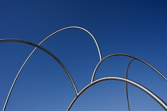Waves of Steel... (Trapac) Tags: barcelona 2003 blue sculpture abstract silver spring spain nikon steel curves tubes 7 arches espanol seven catalunya tubular ones alfaro andreualfaro nikkor1835mm d700 nikond700 plazadelacarbonera 42feettall 15tonnes mimicstheshapemovementofwaves portofbarcelonamarcellsenz
