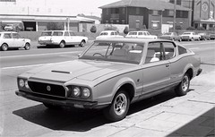 Leyland Force 7 V8 coupe, Newcastle, NSW Motors, 1974 (nelliefryer) Tags: road street bw west history cortina church sports car austin magazine newcastle view wheels australia mini automotive nsw falcon valiant jaguar coupe 1973 v8 holden leyland dealer sacredheart xj6 p76 hunterst caroftheyear force7 nswmotors