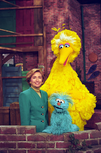 Photograph of First Lady Hillary Rodham Clinton Posing on the Big Bird Nest Set with Big Bird...