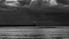 There Is A Light... (whistlingtent) Tags: light lighthouse cloudscape tynemouth pier north shields landscape shadows moody mono black white contrast low key sheen rocks