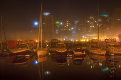 The fog in the marina (Eyesplash - There is a change in the air.) Tags: longexposure winter urban copyright reflection building me water fog architecture vancouver sailboat marina self canon boats eos lights yacht sails foggy pole 7d mast innercity coalharbour condominiums shangrilahotel abigfave eyesplash carderosrestaurant