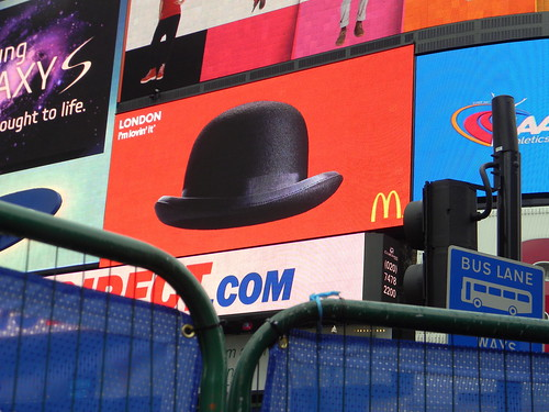 bowler hat MacDonalds advert behind fence eros piccadilly circus 1st February 2011 15:09.40pm