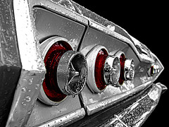 Fever (Explored 2/07/2011) (Flint Foto Factory) Tags: auto winter red bw detail reflection classic chevrolet belair lines car rain vintage cutout 60s automobile gm shiny flickr noir december shine florida geometry circles madonna rear angles explore chevy bumper chrome american round raindrops 1960s 2009 ftmyers taillights fever 1963 leecounty fullsize selectivecolor generalmotors elvispresley fortmyers heyday peggylee explored yougivemefever dedicatedtodad worldcars