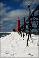 Winter at the Grand Haven Lighthouse (laura's POV) Tags: winter red sky snow black cold ice michigan lakemichigan grandhavenlighthouse grandhavenpier lauraspointofview laursspov