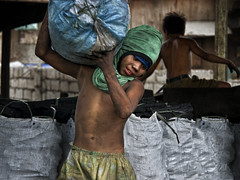 Ulingan, Tondo - Charcoal Delivery (Mio Cade) Tags: family boy kid factory child smoke philippines dirty business dirt charcoal sweat barefoot manila coal heavy load teenage distributor tondo ulingan