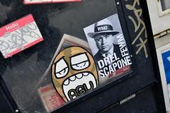 Chicago sticker art (damonabnormal) Tags: street city travel vacation urban streetart chicago graffiti nikon sticker stickerart stickers streetphotography il urbanart graff february feb agu urbanite 2011 d90 citystickers streetstickers thewindycity