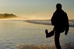 All Them Little Drops (Aaron Licht) Tags: winter selfportrait silly water silhouette sunrise fun bc boots kick vancouverisland longbeach tofino splash waterdrops gumboots oceanfront