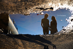 Kenny and Cassidy (David Parks - davidparksphotography.com) Tags: david reflection oklahoma water portraits puddle engagement nikon couple downtown parks okc edmond engage trait d700