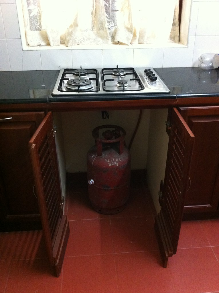 Gas is kept in a cylinder under the stove top