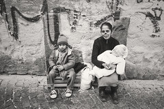 Neapolitan Beggars (TheFella) Tags: street travel family boy people blackandwhite bw italy woman baby slr monochrome sepia digital canon person eos photo italian europe child streetphotography photojournalism photograph processing napoli naples sanlorenzo dslr begging neopolitan 500d beggers noseless twtmemm twtmespw
