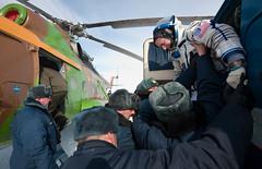 Expedition 26 Soyuz Landing (201103160039HQ) (NASA HQ PHOTO) Tags: nasa helicopter kazakhstan scottkelly arkalyk billingalls allterrainvehicleatv expedition26 expedition26landing