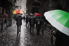 Saturated, Desaturated (TheFella) Tags: street red people italy storm green slr water monochrome rain yellow digital umbrella canon dark eos photo alley europe italia day streetphotography backstreet photograph processing napoli naples desaturated dslr umbrellas selectivecolor selectivecolour postprocessing 500d southernitaly dpsvibrant twtmespw