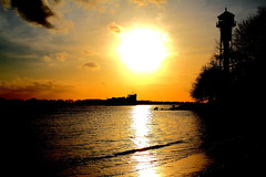 A ship will come (MEK40) Tags: sunset sky orange sun lighthouse black color detail reflection beach nature water colors yellow clouds strand canon river germany landscape deutschland photography eos march photo bush wasser waves ship foto sonnenuntergang details ships hamburg natur wolken beam gelb come rays coming tamron landschaft sonne farbe schiff sunbeam baum mrz elbe sonnenstrahlen schiffe leuchtturm busch farben 550 leuchtfeuer 2011 wittenbergen kommen rissen flus 550d eos550 eos550d
