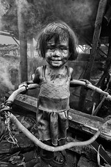 Ulingan, Tondo, Manila - My sweet princess (Mio Cade) Tags: poverty portrait cute girl danger toy factory play princess smoke philippines dirt charcoal manila environment tondo ulingan