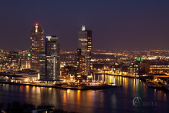 20110320_Rotterdam_0376 (Guido Akster) Tags: new york city bridge sunset sea sky urban building tower industry water netherlands metal architecture night clouds port work hotel harbor pier boat office twilight rotterdam marine colorful downtown industrial ship commerce place skyscrapers sundown erasmus ships towers transport working terminal warehouse business international maritime transportation wharf montevideo elevated maas facility globalisation import trade exchange guido freight euromast zuid eiland noorder erasmusbridge enginering cityimage seafreight retska akster guidoakster cruisetermina