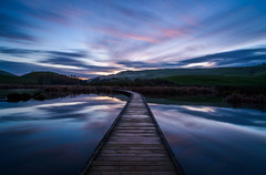 Back after a long time (ajecaldwell11) Tags: boardwalk longexposure mirror hawkesbay newzealand reflection ankh wetlands dawn pekapekaswamp sky water sunrise caldwell clouds light
