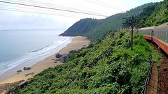 Train Journey over the Hi Vn Pass (vnkht) Tags: railroad sea beach train landscape lumix coast carriage railway vietnam jungle vehicle railwaytrack danang traincarriage 2011 vitnam haivanpass reunificationexpress lx5 haivan nng hivn ngst ohivn ngstthngnht ngstvitnam gavinkwhite