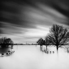 High water (Kees Smans) Tags: longexposure blackandwhite bw water river fineart le nd nik rhine waterscape dikes floodplain daytimelongexposure bwnd110 silverefexpro keessmans wwwbwfineartcom 2011keessmans highwaterriverrhine