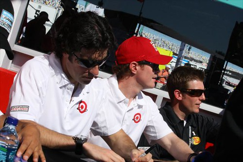 Dario Franchitti and Scott Dixon sign some autographs with teammate Jamie McMurray