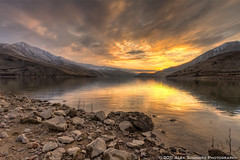 Winter Sunset over Brownlee Reservoir (www.alexsommersphotography.com) Tags: longexposure winter sunset orange mountains nature clouds canon eos rocks id dramatic wideangle reservoir idaho 7d ripples usm dslr efs hdr 1022 manfrotto topaz photomatix cs5 f354 brownleereservoir httpwwwalexsommersphotographycom