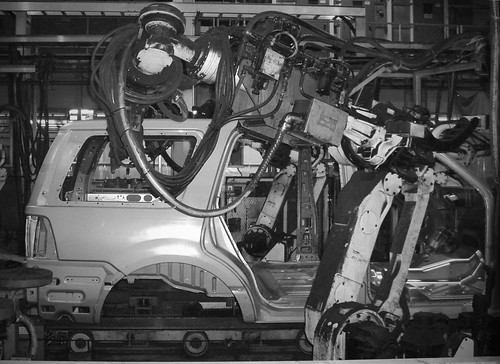 black and white photo of automated car assembly