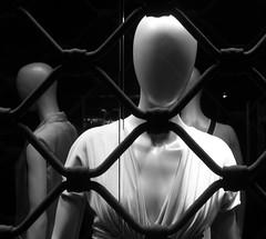 prigionieri (sand-creek) Tags: bw woman mannequin shop donna faceless indifference faccia prigione sbarre manichino