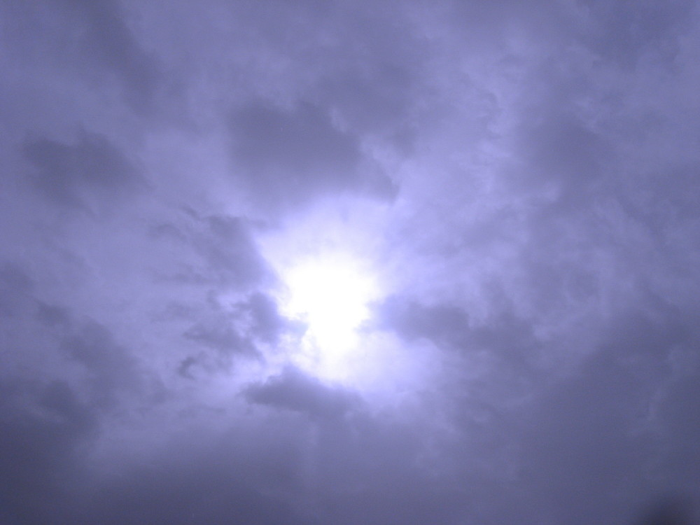 04-02-2011-sun-looking-thru-a-hole-in-the-clouds-at-the-cotel