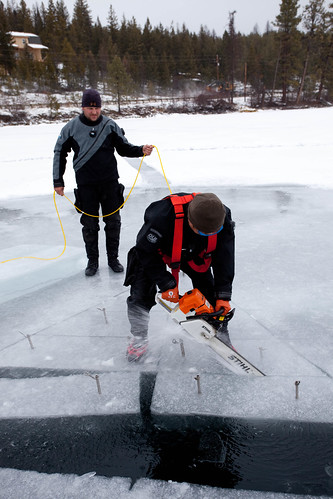 Chainsaw + ice = diving hole
