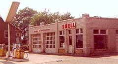 BELTSVILLE SHELL STATION IN 1969. (THE ENIGMATIC TRAVELER) Tags: building cars car automobile gasstation greenbelt petrol laurel collegepark fillingstation beltsville automobilia princegeorgescounty marylandgasoline