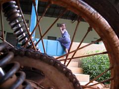(Francesco Tassara) Tags: africa travel wheel composition hospital ray child african reporter moto motorcycle togo viaggio reportage raggi ruota afrique composizione bambina bambino raggio africanpeople blackafrica tassara francescotassara